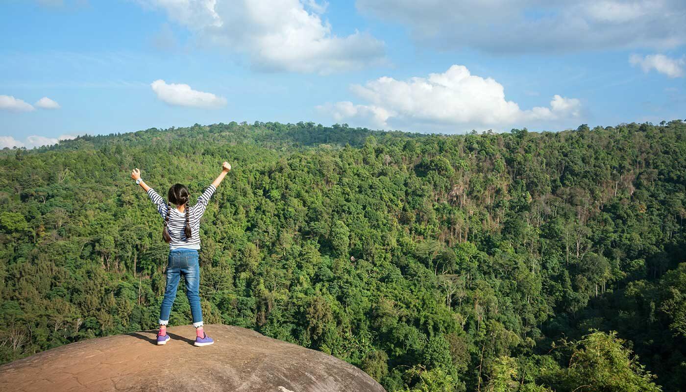 girl standing on rock